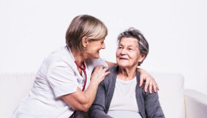 Studio portrait of a senior nurse and an elderly woman.