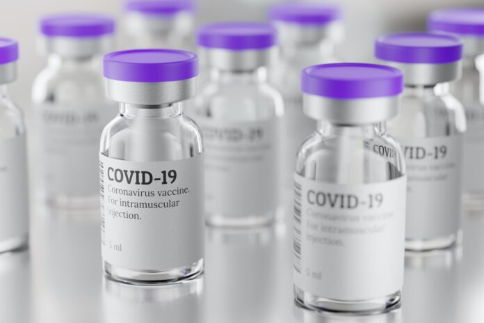 Lot of COVID-19 vaccine glass vials, 3d rendering illustration.