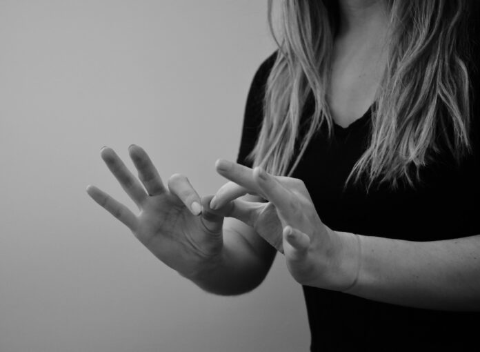 Woman interpreting sign language in black and white